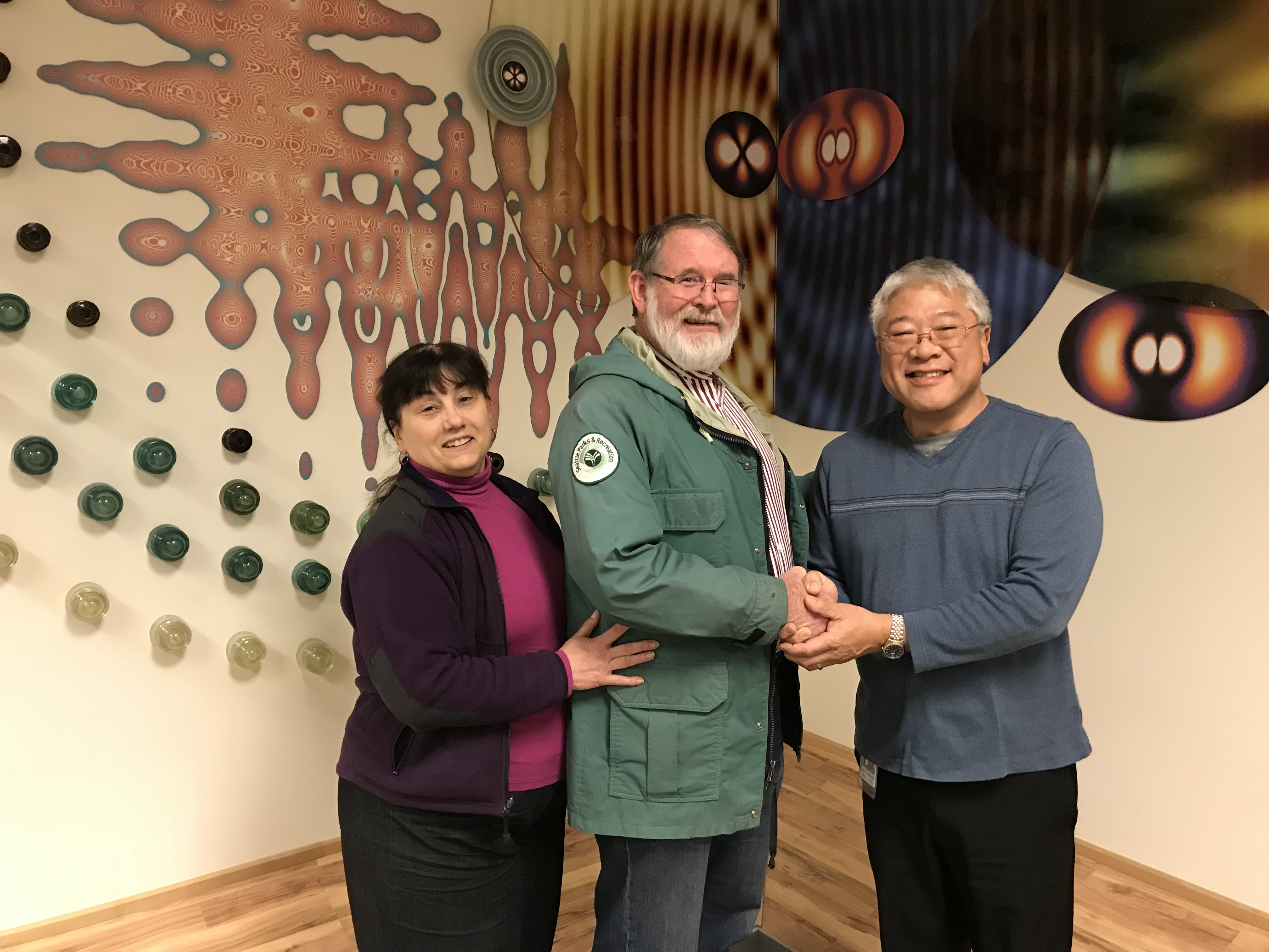 Allan Yamaguchi accepting check from Richard Frith 12/27/2017