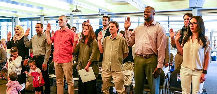 New Americans taking the oath.