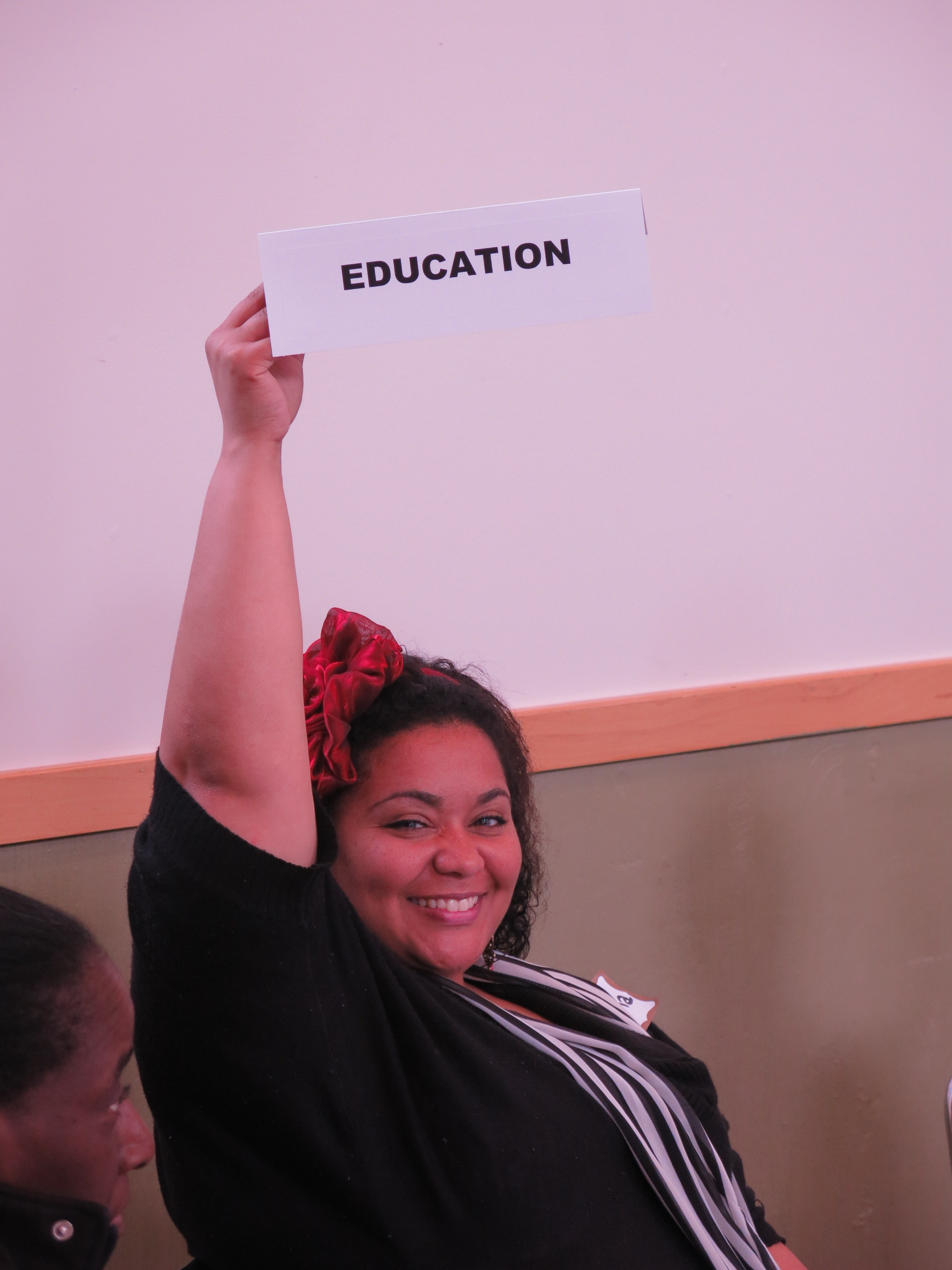 "Participant holding a sign that says ""Education"""