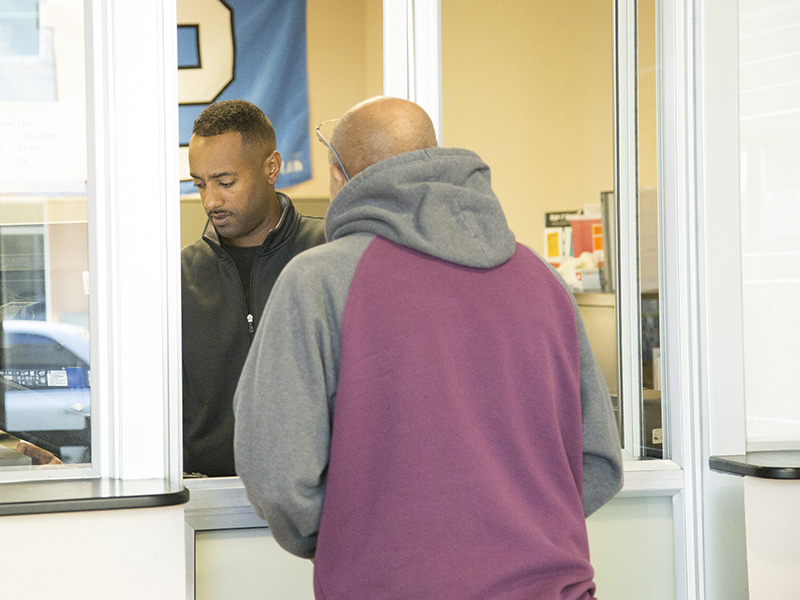 Staff member helping a customer at the Southeast Customer Service Center