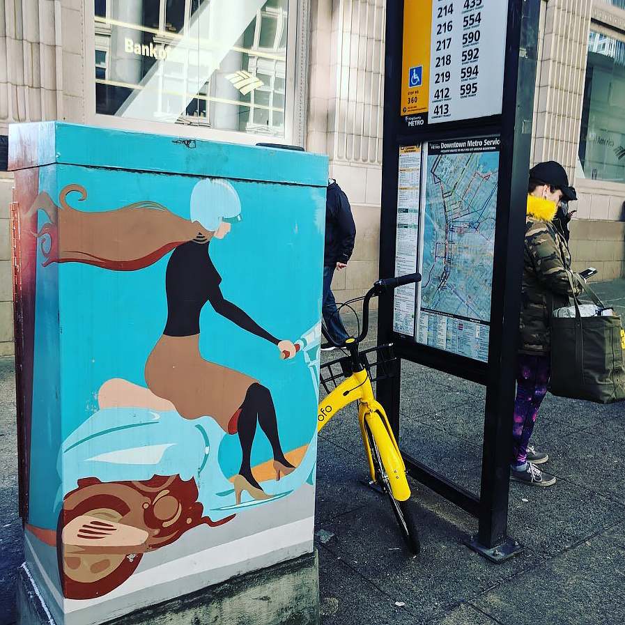 Public Art on Utility Cabinet Blends with Bike Share Bike at Transit Stop