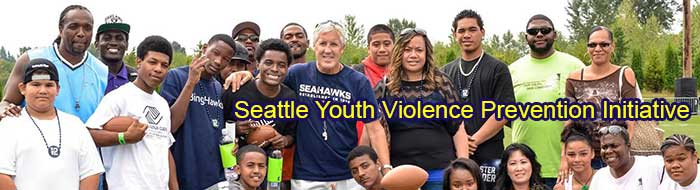 Seahawks coach, Pete Carroll, with kids
