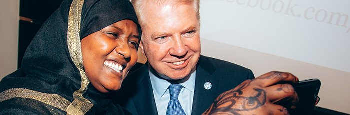 A new U.S. citizen takes a celebratory selfie with Mayor Ed Murray.