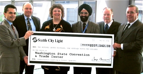 City Light and Convention Center officials with the ceremonial check