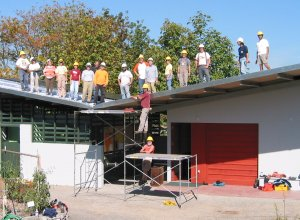 Community volunteers install the solar array.