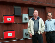 Parks Project Manager Dan Johnson and Architect Geordie Selkirk with solar inverters