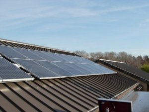 Solar modules mount easily to the building's metal roof.