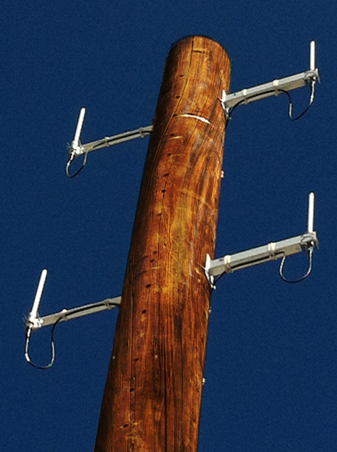 Rendering of wireless utility data equipment on a utility pole.